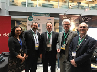 OncoTherics and UHN sign MoU. Left to right ar Bharti Ranawaya (BDM, UHN), Mark Taylor (Director of Commercialisation, UHN), Stefan Ogrodzinski (CEO OncoTherics), John Reid (Director TD&C, UHN) and Laurence Patterson (Chair, SAB OncoTherics).